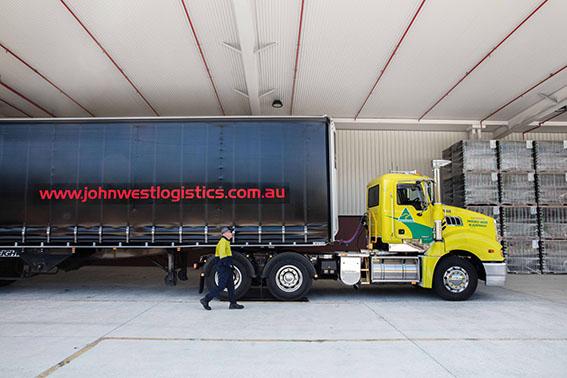 John West Logistics Australian Made Mack Trident and Employee