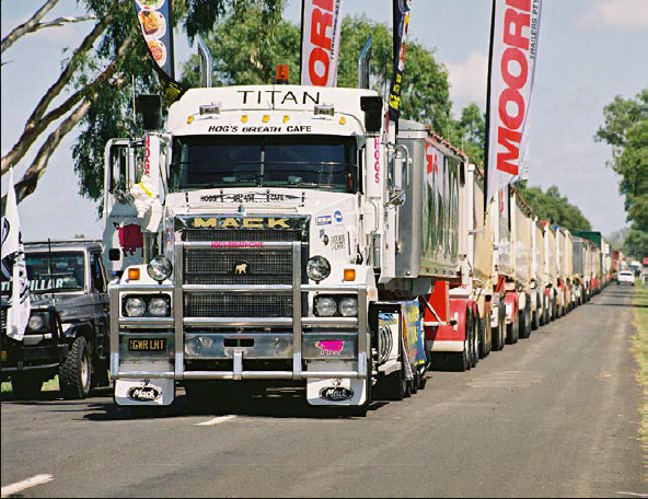 A Mack Titan truck sets the world record for pulling the largest Road-train