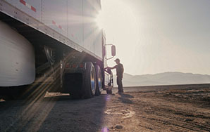 Driver by truck with shadow