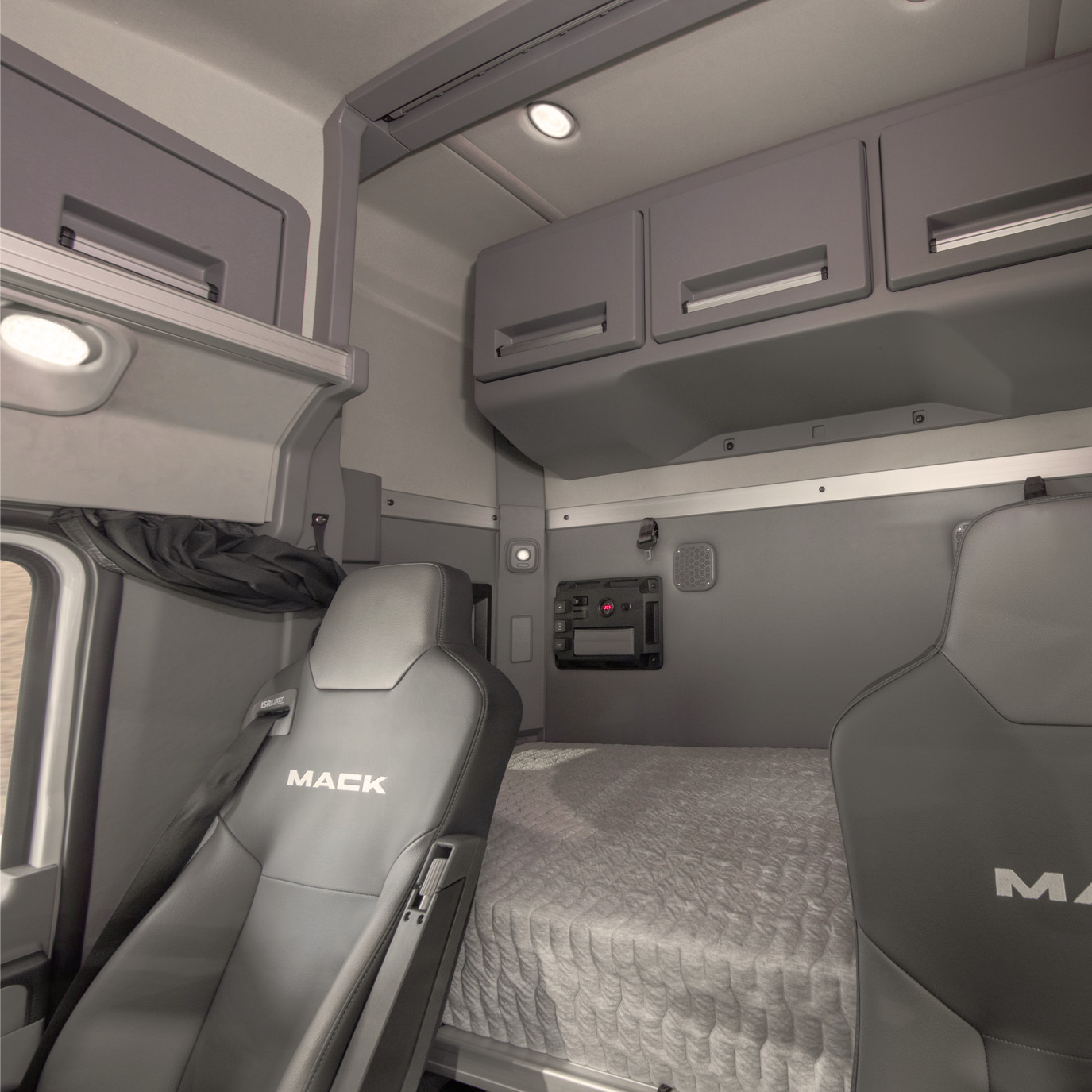 "Driver view of the Anthem 36"" Stand Up Sleeper interior environment with sleeper bunk.."