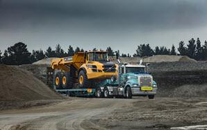 Mack Truck Super Liner carrying Volvo Hauler